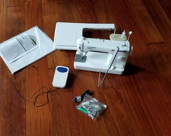 white mighty mender w100 sewing machine