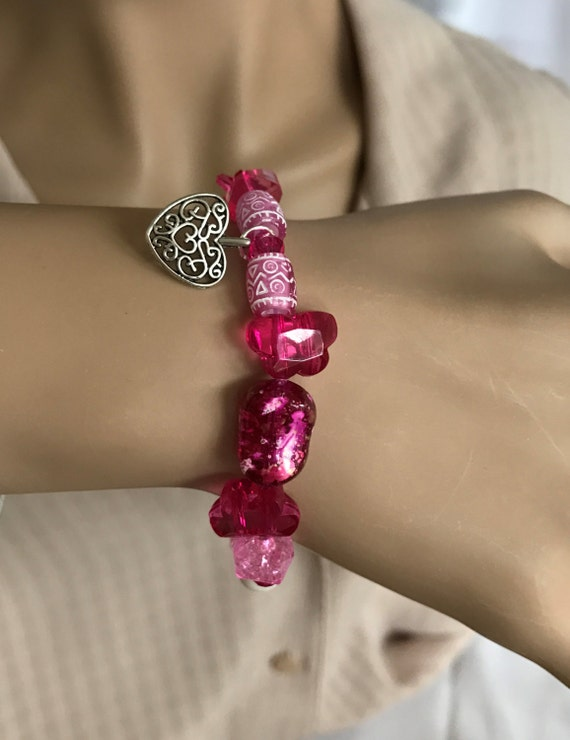 Essential Oil Bracelet Diffuser. Variety of Pink Acrylic Beads on Stretchy Elastic. White Aroma Bead for Essential Oils. Silver Heart Charm.