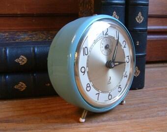 French vintage round blue mechanical alarm clock. Sky blue alarm clock. 1950s alarm clock. Mid century modern. Loft decor. Industrial.