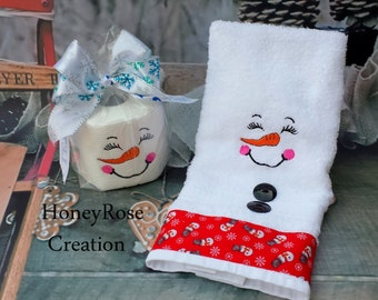 Snowmman towel and toilet paper.Embroidered snowman.