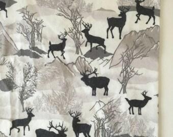 Grey deer and mountains receiving blanket