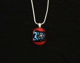 Red, blue, and black fused glass pendant