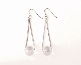Clear sphere dangle earrings