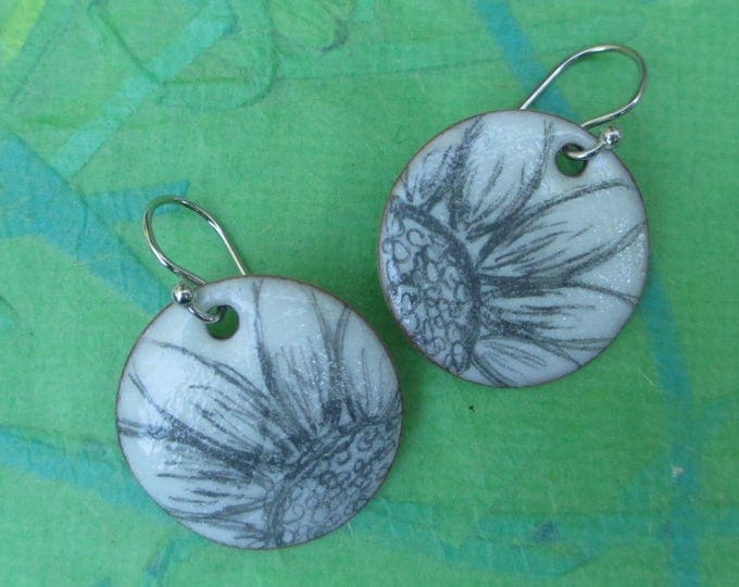 white torch fired enamel earrings with flower drawing and sterling silver ear wires