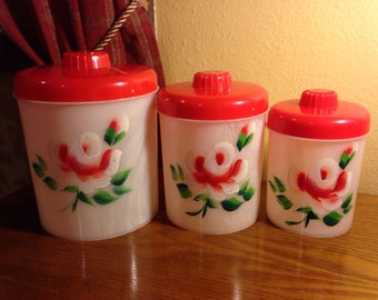 Vintage Lucite Red and White Floral Canister Set of (3)