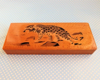 Vintage wooden pencil box hand stencilled with a leopard.