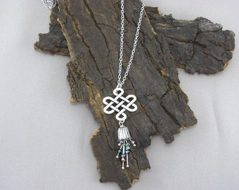 Celtic knot with sparkling flower silver chain