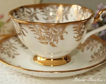 Royal Albert, England: White and gold tea cup & saucer