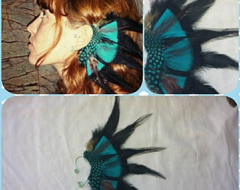 Left ear. Handmade black and turquoise feather ear cuff