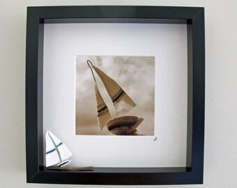 Box set sail boat sculpture with art photo