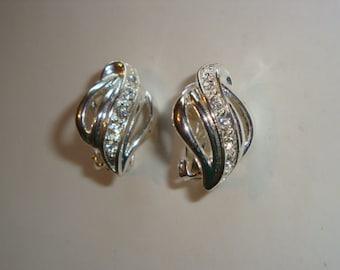 Swirl Silver Tone Clip Earrings with Rhinestone Center