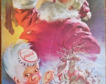 """1949 Coca Cola Santa ad. 1949 Coca Cola ad.  Haddon Sundblom.  Santa Coca Cola ad.  1949 Coke Christmas ad.  Full Color.  7""""W x 10""""H."""