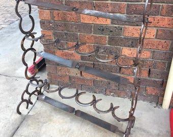 Horse shoe boot rack horseshoe