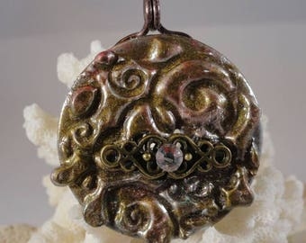 Stamped soldered ,patinad and embellished  washer pendant.