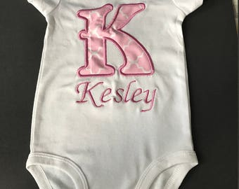 Baby girl intial customized onesie.