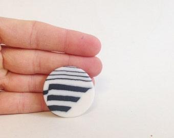 round porcelain brooch