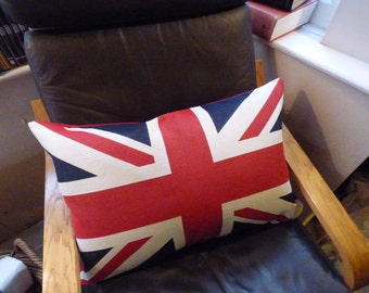 Union Jack pillow sham. Tapestry style front of Union Jack flag. Red canvas back with zip at base.