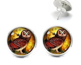 14 mm OWL glass cabochon studs before a watch