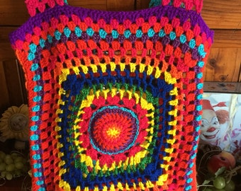Bright rainbow coloured crocheted vest