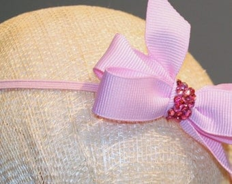 Swarovski crystals on grosgrain bow on skinny elastic headband for baby