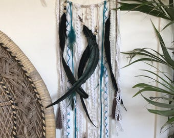Boho indian style dreamcatcher with black rooster feathers