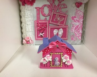 pink house shape timber money box with pony and flowers