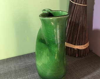 Beautiful green vase. Free-form. Signed CD. Very good condition.