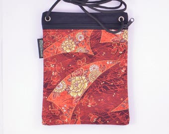 Cross body cell phone bag. Red and Gold flowers.
