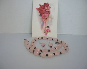 large pink beads on a necklace