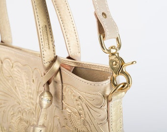 Add a detachable strap to the hand tooled tote