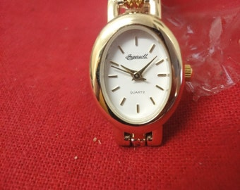 Ladies Ingersoll gold watch with oval face still in wrapper   NEW!