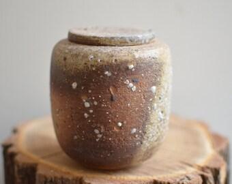 Brown ceramic jar