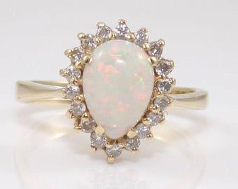 14K yellow gold ring set with an Opal + 18 0.25 carats diamonds