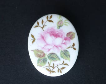 Oval white porcelain brooch with pink flower