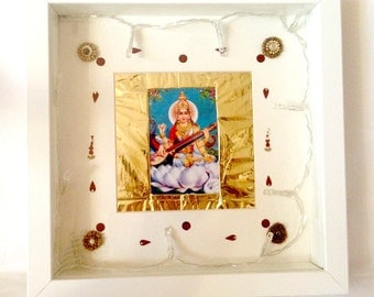 Saraswati lit altar | Inner wisdom. Hindu goddess of the arts and music. Goddess of creativity | Wall painting of Hindu goddess Saraswati.