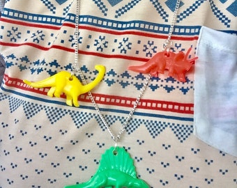 A trio of dinosaurs charm necklace!