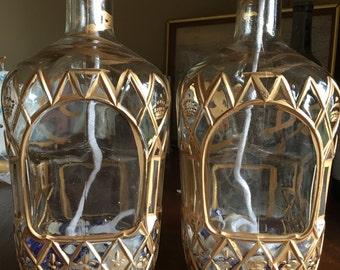 Torches,set,Crown Royal bottles, Large,gold leaf trim, quarter filled with broken blue glass and shells
