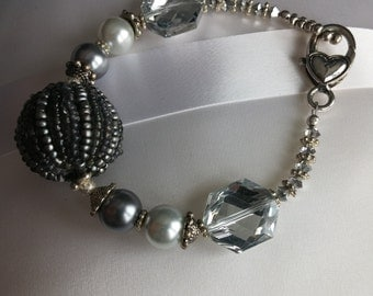 Large bead focal beaded bracelet. 10 4mm Swarovski Crystals combined with Glass Pearls and easy to use heart pendant clip.