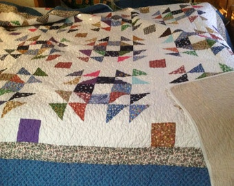 Beautiful Homemade over queen size quilt.  One is queen size 88x100. It's 200.00