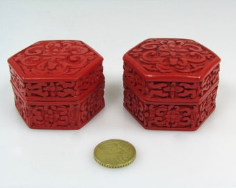 Pair of boxes in red lacquer and cloisonne