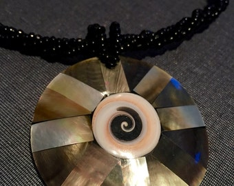 Shell pendant on a beaded necklace - statement piece