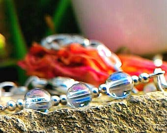 Bracelet in Aqua Aura, very high frequency energy which resonates with the realm of the angels.