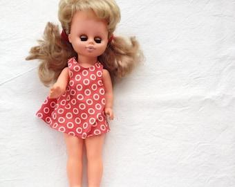 Vintage doll. Blinking blue eyes blondie hair doll. Plastic rubber doll. Red dress doll. Girl in sandals