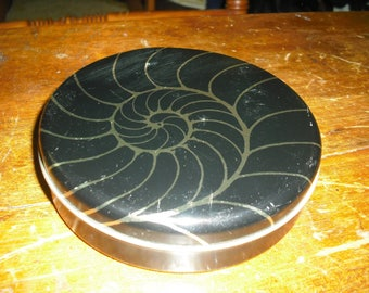 Avon's Sea Treasure Soaps come in a black tin with gold trim in a snail shape.