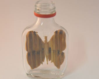 Tiny Butterfly in miniature bottle
