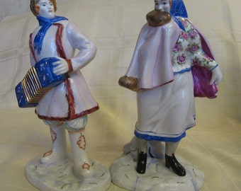 Soviet porcelain. Accordion player and Dancing. SC. B. Kustodiev LZF