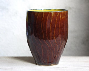 tea cup, coffee cup, unique pottery, designer ceramics, faceted surface, texture, brown, yellow, modern ceramics
