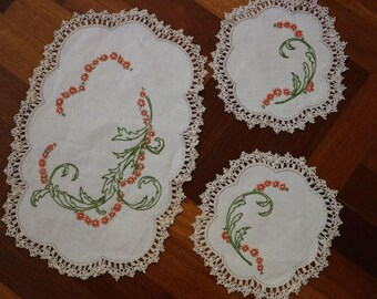 Ivory linen Doiley set with embroidered orange daisies edged in pretty crochet lace.  Proceeds to charity VACD Ltd