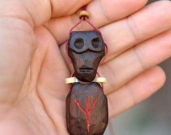 Protective amulet against negative impacts.