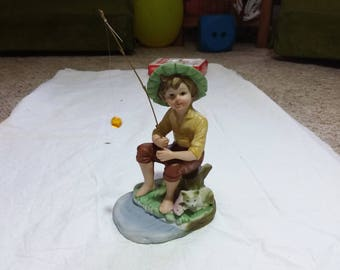 Vintage boy and his cat sitting on stump fishing, pole comes out of hand. Beautiful piece. Had sticker on bottom. Figurines figurine